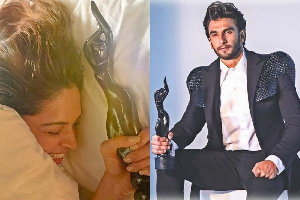 ranveer shares photo when deepika react to see his filmfare trophy