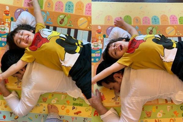taimur ali khan playing with sleeping father saif kareena share pictures