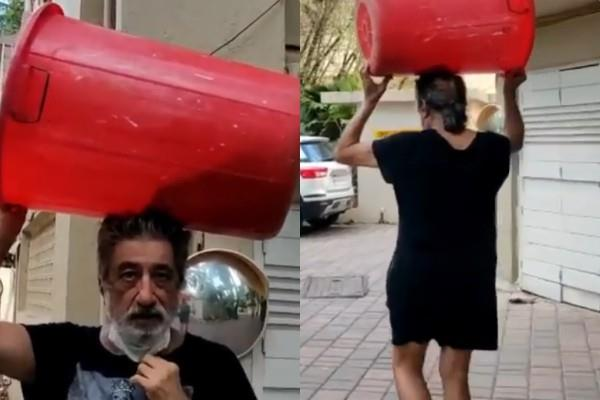 shakti kapoor carries a drum to buy liquor video viral