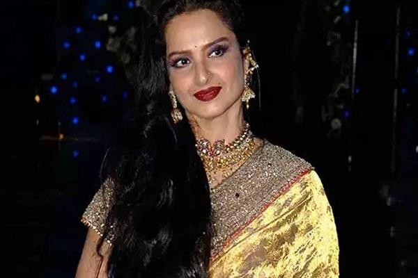 rekha under home quarantine after staff tested corona positive