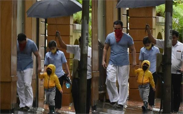 Pic of the Day: मुंबई की बारिश में पापा संग सड़क पर टहलते दिखे तैमूर, देखें तस्वीरें
