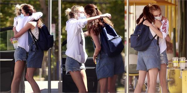 cara delevingne and margaret qualley seen kissing in mask