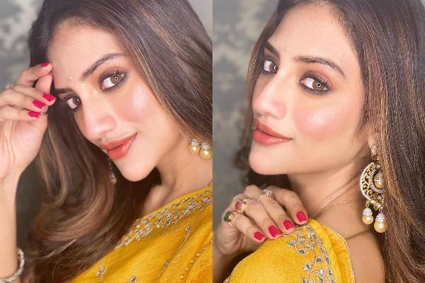 nusrat jahan shares her glamorous photos