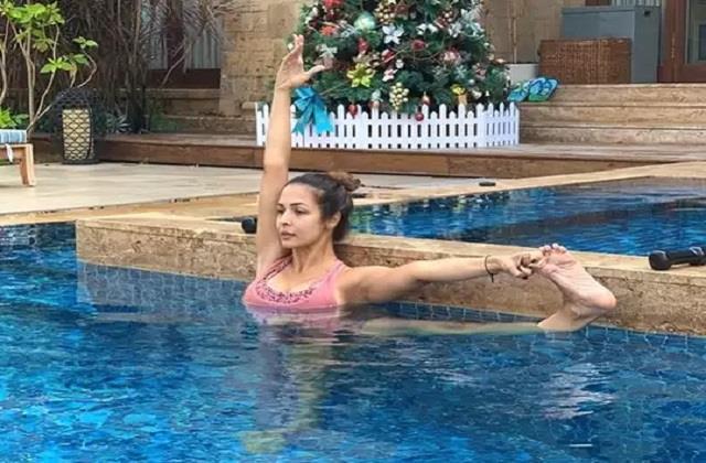 malaika arora yoga in swimming pool