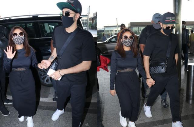 neha kakkar stylish appearance at airport with hubby rohanpreet singh