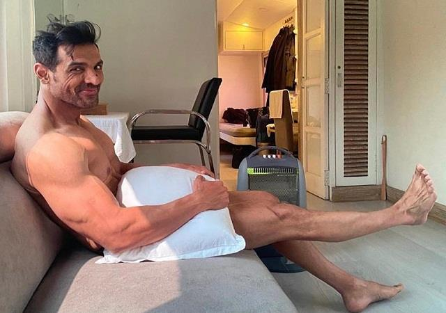 john abraham shared a photo with pillow