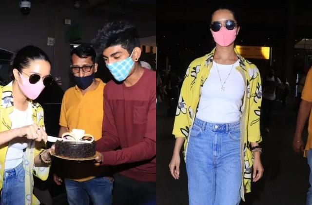 shraddha kapoor cuts birthday cake with paparazzi at airport