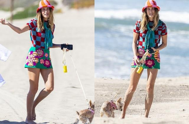 hailey bieber walks her dog on beach in malibu