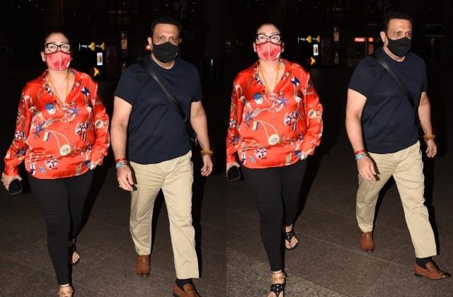govinda spotted at the airport with wife sunita ahuja