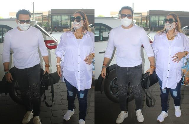 govinda spotted at airport with wife sunita after recovering from coronavirus