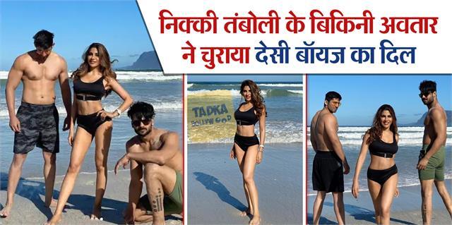 nikki tamboli posed with her desi boys varun vishal on beach