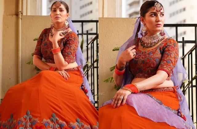 sapna choudhary shares her photos in orange lehenga