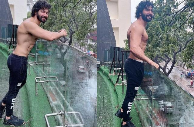 varun dhawan enjoys rain photos viral
