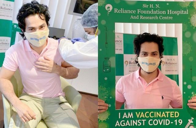varun dhawan takes first dose of covid vaccine