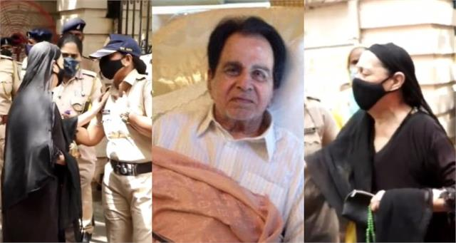 a lady fan try to get last glimpse of dilip kumar outside his residence
