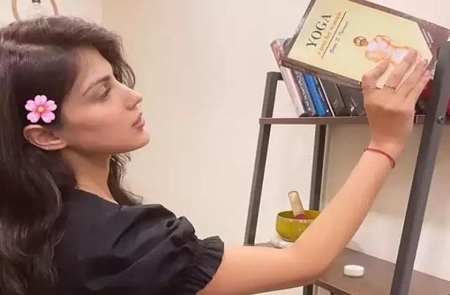 rhea chakraborty shares her photo with yoga book