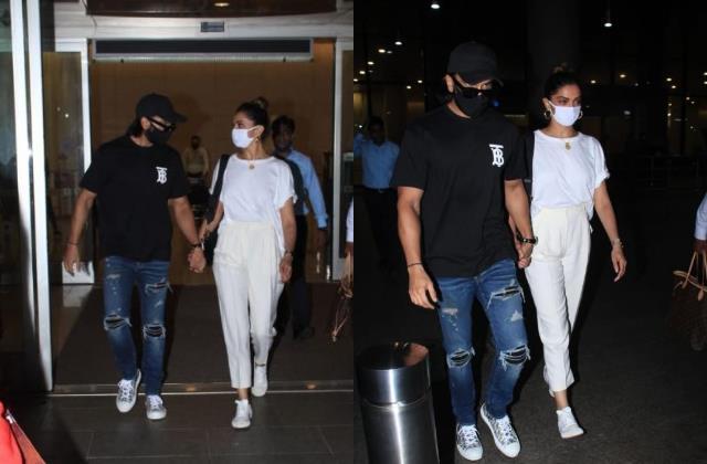 deepika padukone and ranveer singh walk hand in hand at the airport