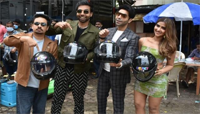 aparshakti khurana pranutan bahl and team distribute helmets to the paparazzi