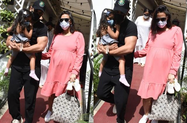 pregnant neha dhupia reached the restaurant with husband and daughter