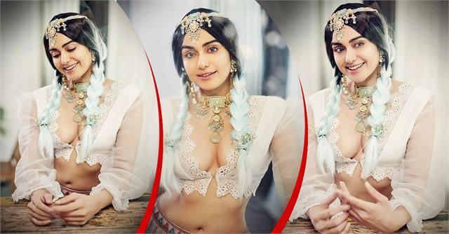 adah sharma looks hot in white blouse
